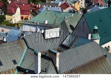 multicolored roofs of old European city houses . top view