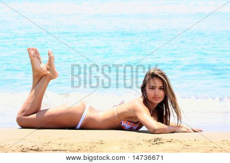 Beautiful young sexy Brazilian model by the sea