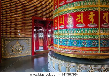 SINGAPORE, REPUBLIC OF SINGAPORE - JANUARY 09, 2014: The Vairocana Buddha Prayer Wheel is the largest cloisonne BuddhaPrayer Wheel in the world. Buddha Toothe Relic Temple, Chinatown, Singapore city