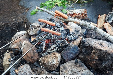 Extended family cooking barbecue in park in mountain