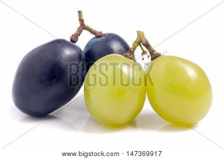 green and blue grapes isolated on white background.