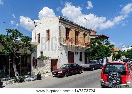PALEOCHORA, CRETE, GREECE - JUNE 2016: Street of Paleochora town with parked  cars on Crete island, Greece