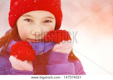 portrait of a teen girl on a walk in the winter. teen outdoors