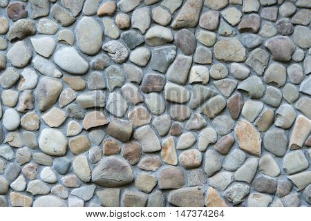 wall texture with a stone on a white background