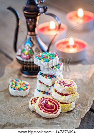 Heap Of Turkish Delight With Burning Candles
