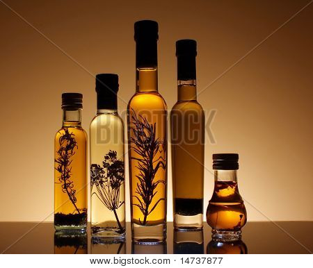 Collection Of Bottles Of Olive Oil.