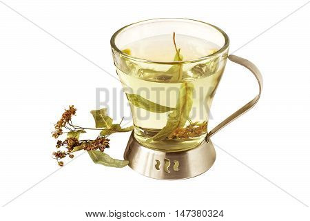 Useful herbal tea with dried linden flowers (Tilia) isolated on white background. Used in healthy nutrition and herbal medicine