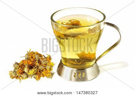 Useful herbal tea with calendula in a cup and handful of dried marigold isolated on white background
