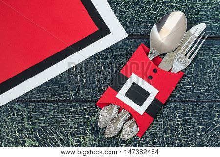 Creating a festive decoration for the table setting for Christmas in the shape of jacket Santa Claus. Step by step photo instructions. Step 5. Cutlery in a case in the shape of jacket Santa Claus