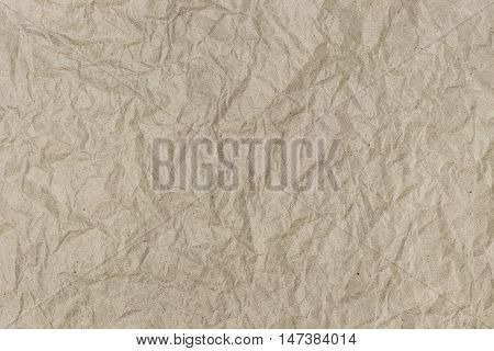 Background of crumpled wrapping paper with a lot of small detail texture