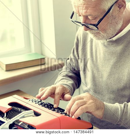 Senior Adult Typing Typewriter Concept