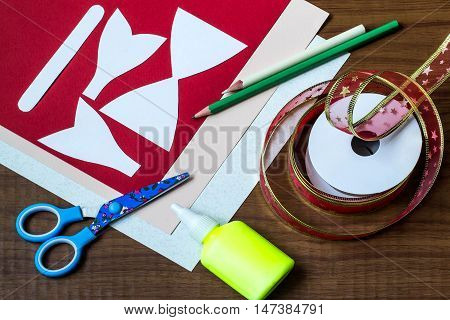 Making original bow in the form of Santa Claus for decoration Christmas gifts. Step by step photo instructions. Step 1. Preparation of materials (colored cardboard glue templates) and tools