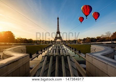 Hot air balloon with sunrise in Eiffel Tower in Paris France. Eiffel Tower is famous place in Paris France.