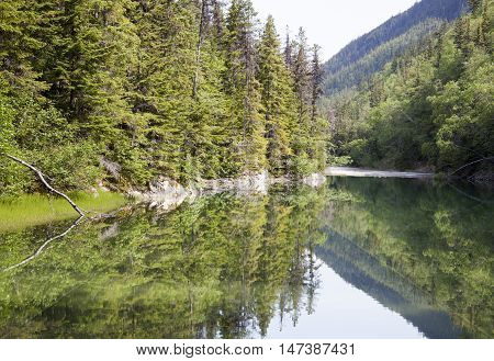 Calm waters of Lower Dewey Lake in late Spring (Skagway Alaska).