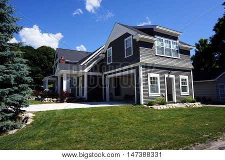 HARBOR SPRINGS, MICHIGAN, UNITED STATES - AUGUST 1, 2016: The attached garage of a new home, designed and built by Bob Michels, in Harbor Springs.