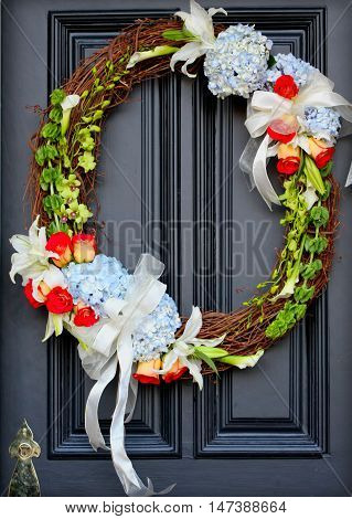 Spring Oval Grapevine wreath with greenery and ribbon