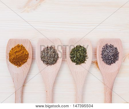 Food Cooking Ingredients Dried Spices Herb In Wooden Spoon Curry Powder ,black Pepper,dried Thyme An