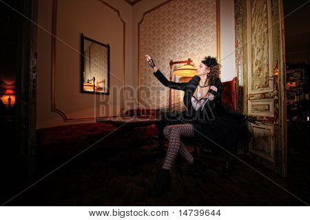 Beautiful fashion model sitting on a luxury sofa