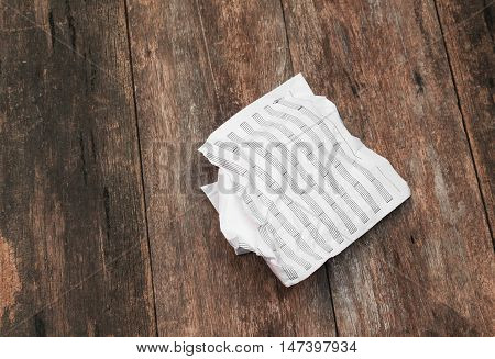 White paper sheet  note rip Pieces and crumpled on a wooden floor background  with copy space