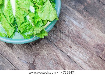 Chinese cabbage organic vegetables Soak and wash on the wooden floor.