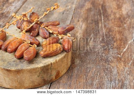 Dried date palm. fruit Delicious fresh organic date palm on the wooden floor :Close up