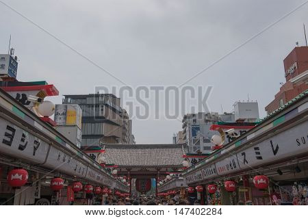 TOKYO  , JAPAN - MAY 2 , 2016:  Nakamise shopping street in Asakusa, Tokyo, Japan. MAY 2 2016. Walkway shopping road to Senso-ji Temple