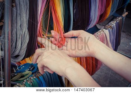 Vintage Photo, Hand Of Woman With Colorful Necklace On Stall At The Bazaar