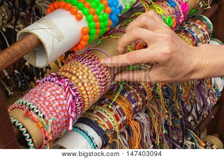 Hand Of Woman With Colorful Bracelets On Stall At The Bazaar