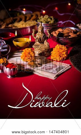 Happy Diwali Greeting card showing oil lamp or diya with crackers, sweet or mithai, dry fruits, indian currency notes, marigold flower and statue of Goddess Laxmi or Lakshmi on diwali night