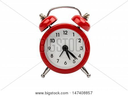 red alarm clock on a white background