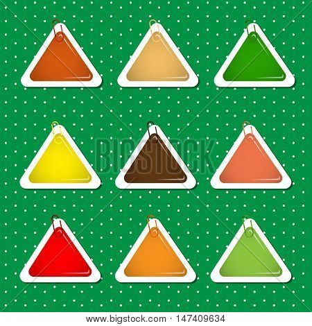 Triangle paper sticker shapes with paper clips in warm autumn colors.