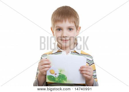 Boy holding sheet of paper with flower