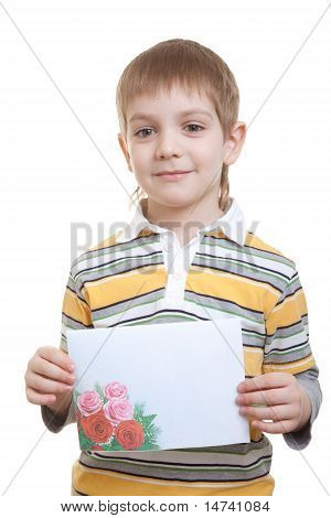 Boy holding sheet of paper with flowers