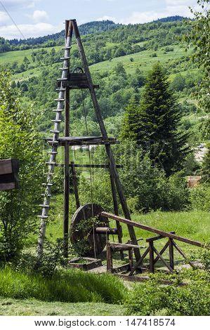 old fashioned wooden oil pump of 19th century at Schidnica L'viv region Ukraine