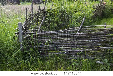 close-up old wicked wooden fence at the village