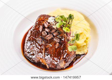 Grilled beefsteak with mashed potato garnish, fine dining