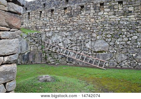 Modern Ladder Among Old Walls