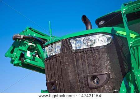Close up of tractor on a blue sky background