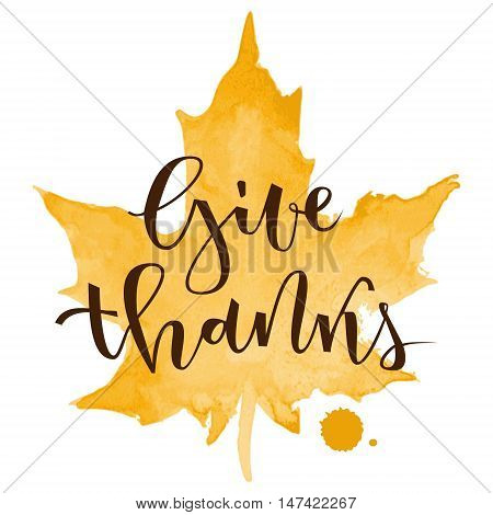 Give thanks hand lettering greeting with orange watercolor maple leaf on white background