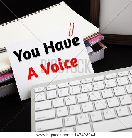 Word text You have a voice on white paper card / business concept