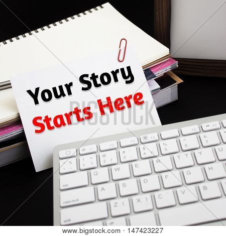 Word text Your story starts here on white paper card / business concept