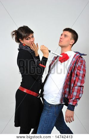 couple with red heart and knife