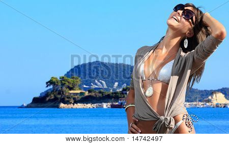 Beautiful young woman relaxing by the beach in Greece