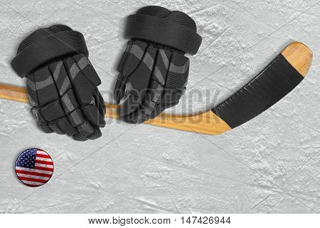 American hockey puck stick and gloves on the ice arena. Concept