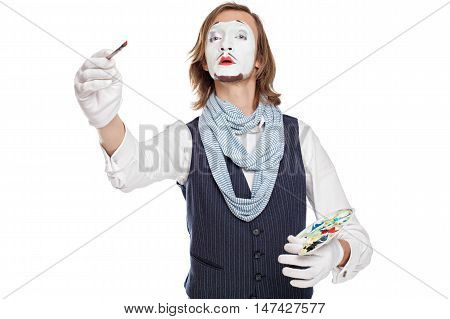 mime actor play the painter drawing an imaginary picture