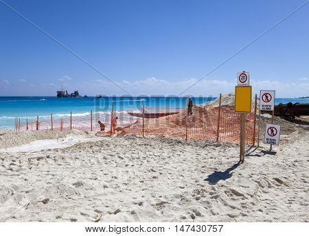 laying new sand on the beach. Mexico.