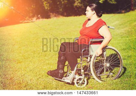 Woman with broken leg in wheelchair