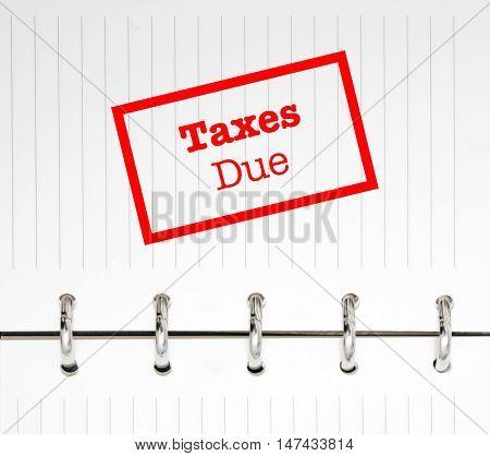 Taxes due written on an agenda