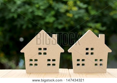wooden toy house with blurred green natural background