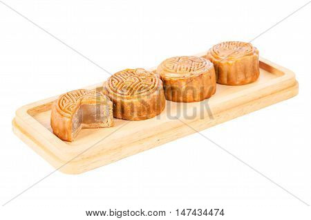 Mid-Autumn Festival moon cake in wooden dish isolated on white background Saved clipping path.
